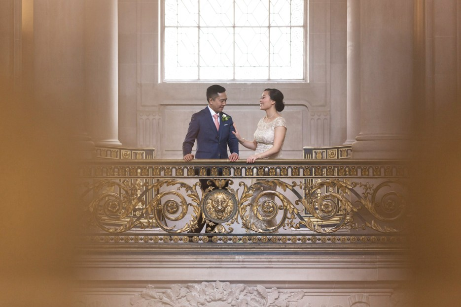 bride and groom share candid moment photographed from afar