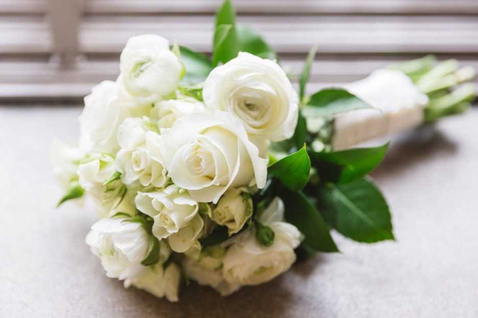 simple white floral bouquet placed on windowsill at sf city hall