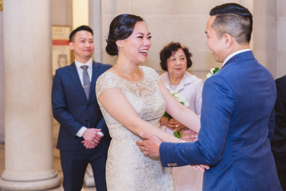bride and groom embrace after tying the knot at city hall