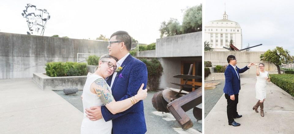 bride resting on groom's chest in beautiful oakland wedding venue omca omca oakland museum of california