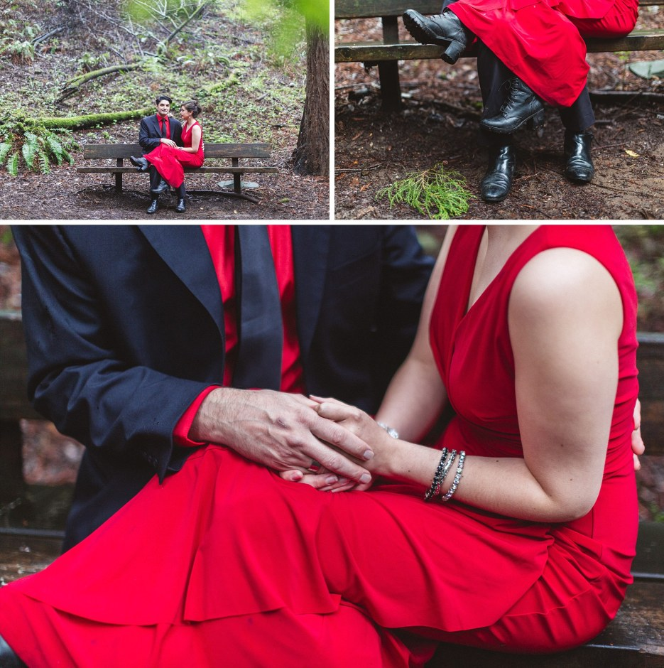 engaged couple sits on bench in forest in bold red and black outfits