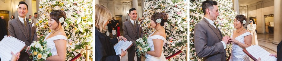 couple saying wedding vows in front of christmas tree