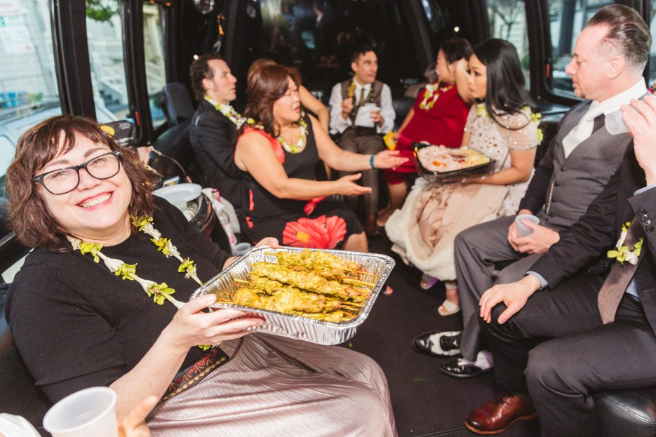food is served for excited group in back of limo