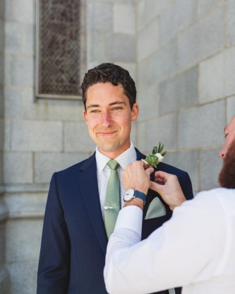 san francisco groom boutonniere pinning outside church