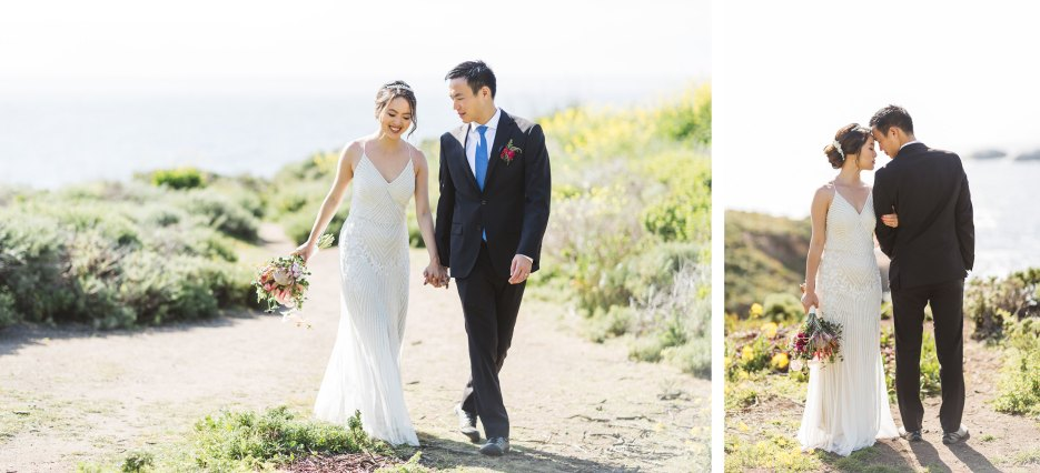 couple on monterey beach with blown out ocean