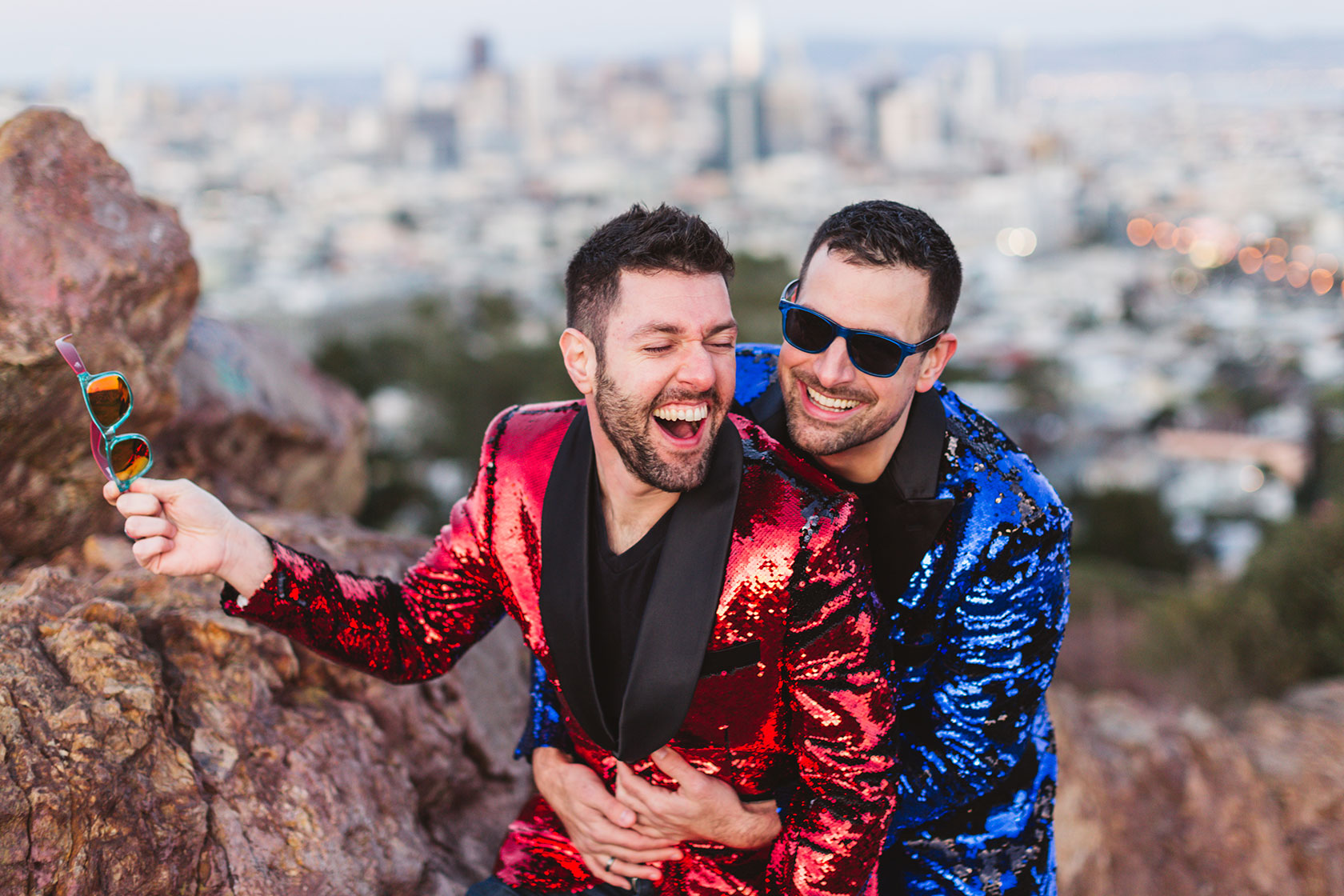 gay male couple in matching sequin jackets at corona heights