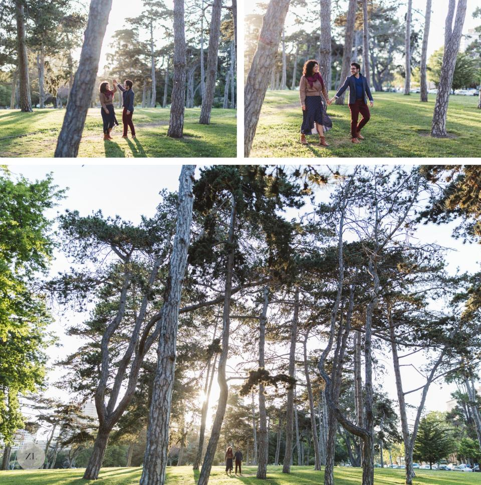 epic wide shot of couple on engagement shoot underneath huge trees backlit