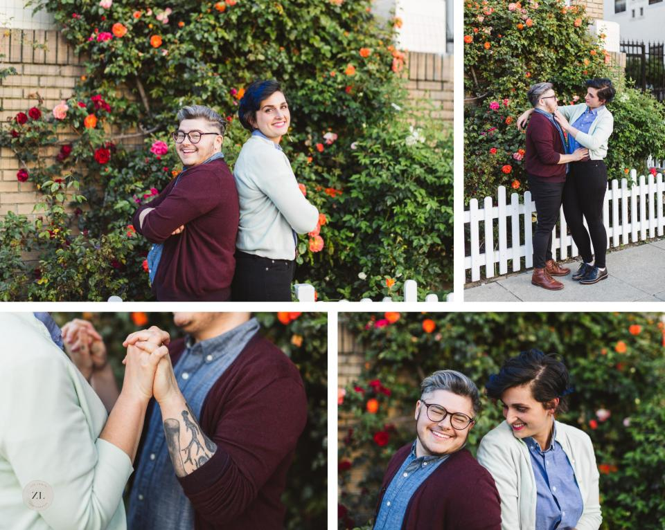 queer forward couple on engagement shoot with rosebush in background