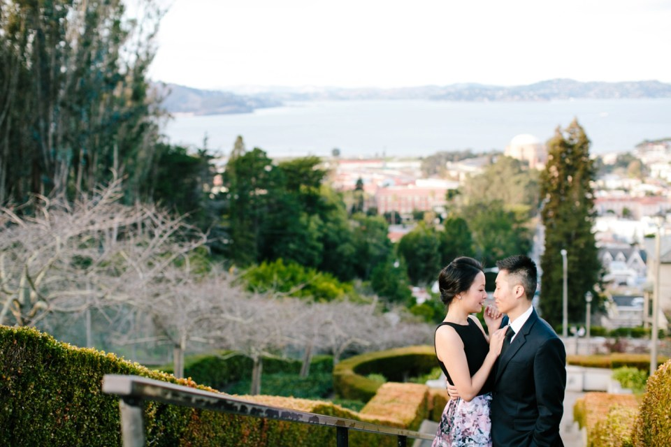 couple standing on top of lyon street steps in pacific heights