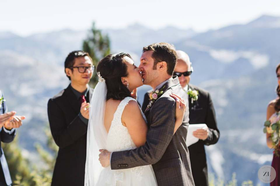 first kiss at Glacier Point Amphitheater Wedding by Zoe Larkin Photography