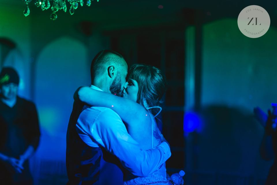 couple with colorful disco lights on dancefloor at monte verde inn