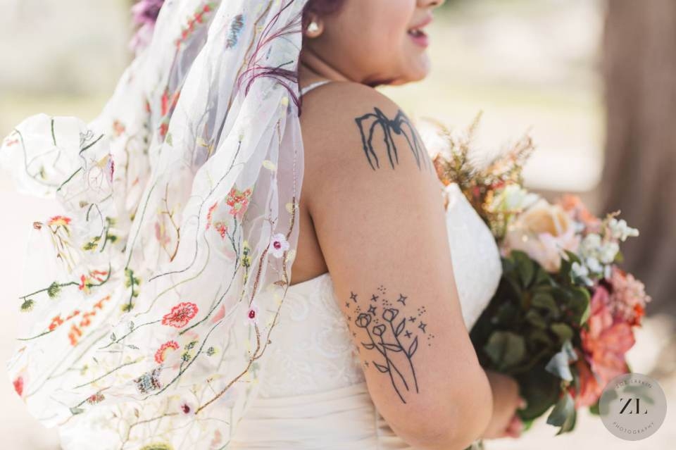 bride's tattoos shown off in her wedding dress by San Francisco photographer