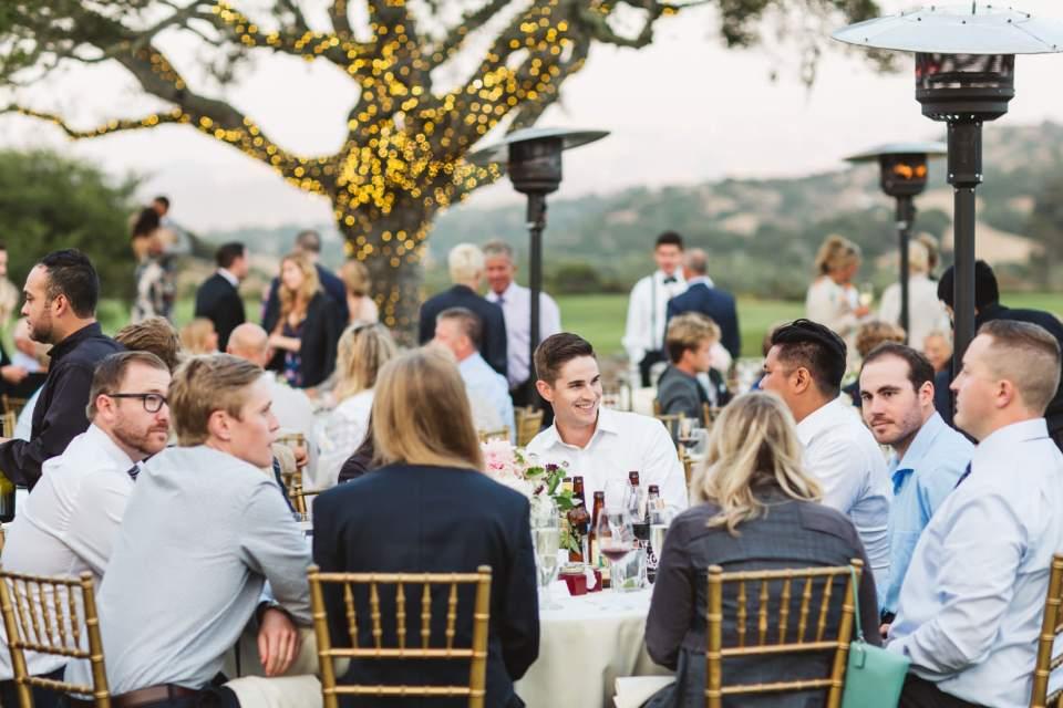 Group of people celebrating a wedding - photography by Zoe Larkin