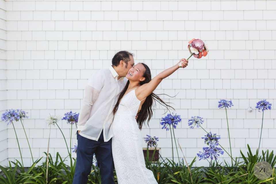 joyful wedding couple celebrating their covid wedding