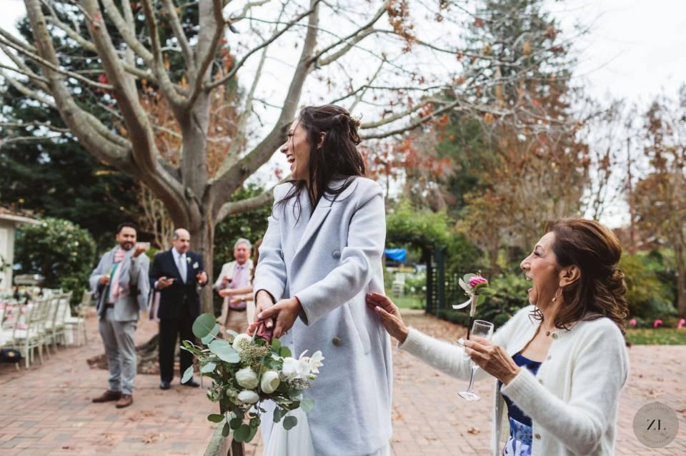 bride tosses bouquet at her intimate wedding in the Elizabeth F Gamble garden