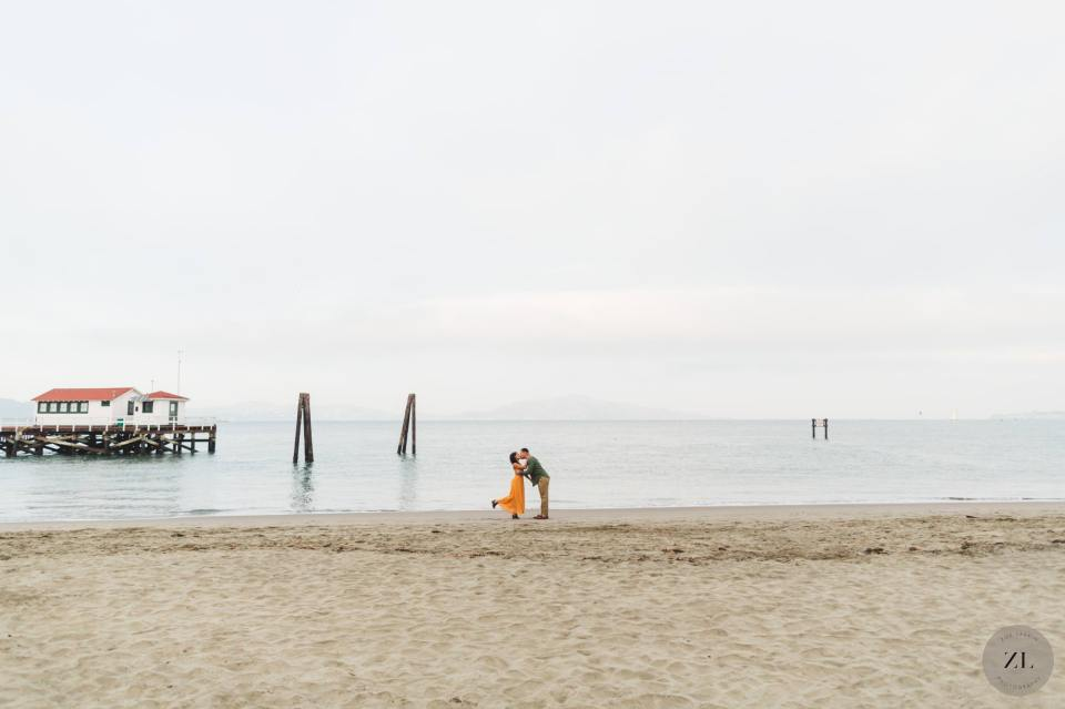epic wide shot of couple on the beach at Crissy Field, san francisco
