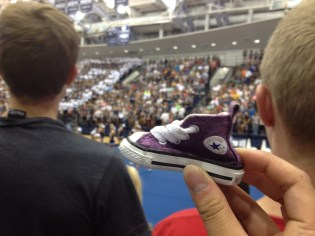 Here, Mr. Shoe is tapping some kid on his shoulder during the pep rally.