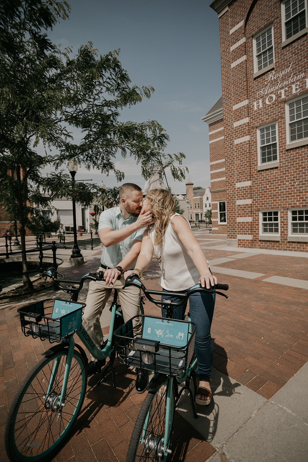 spring engagement session in downtown pella with bikes