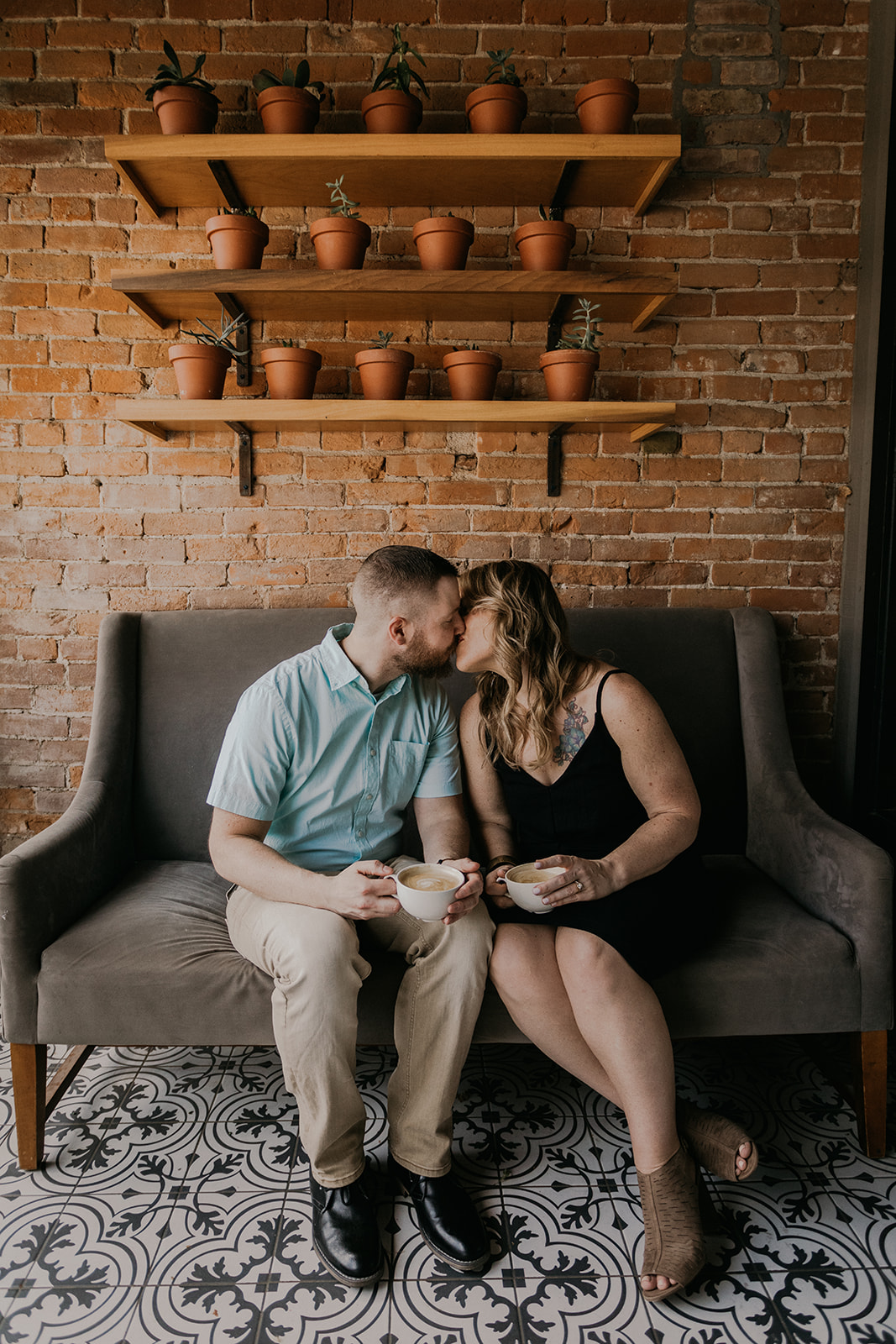 spring engagement session in downtown pella coffee shop