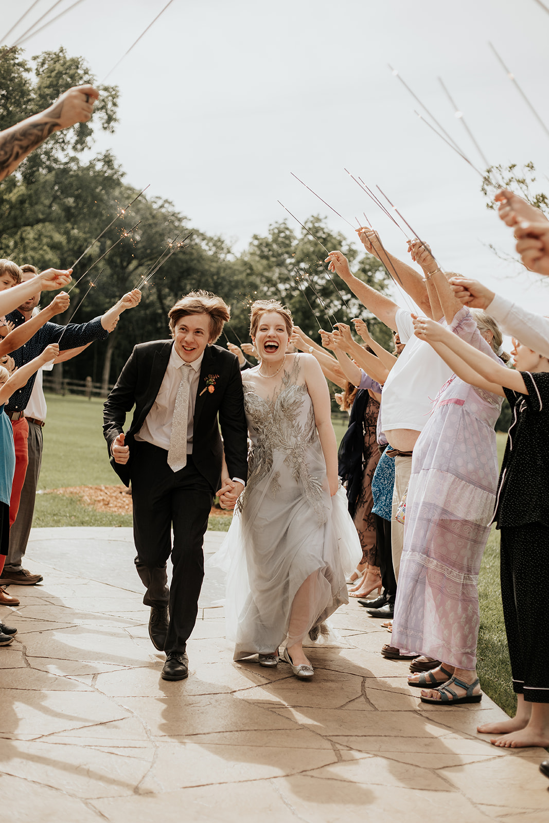 intimate summer wedding in minnesota daytime sparkler exit
