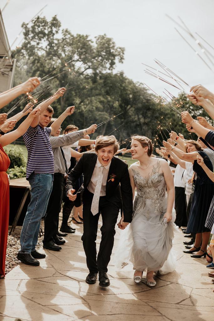 intimate summer wedding in minnesota daytime sparkler exit