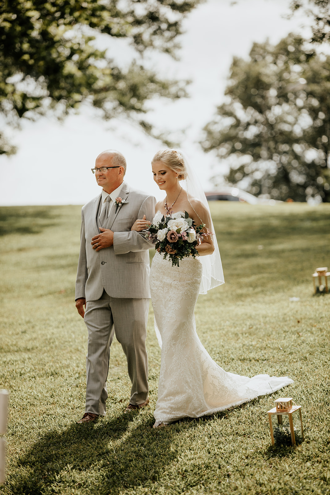beautiful bride walking down the aisle with dad