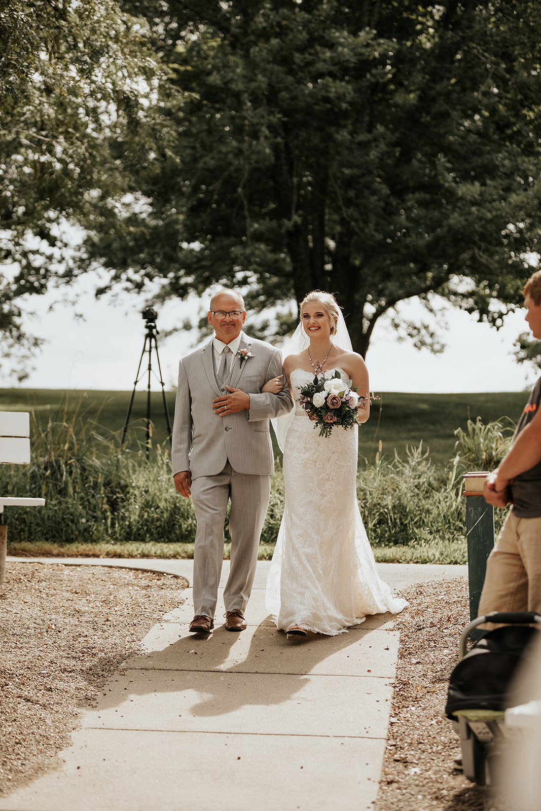 bride walking down the aisle with dad sees groom for first time