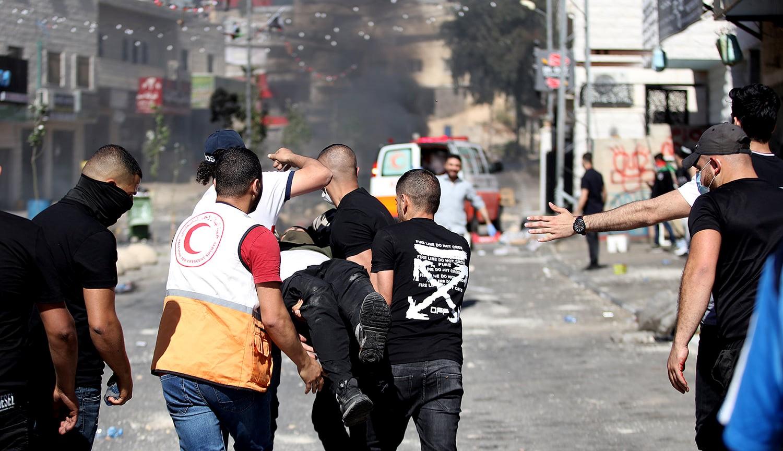 הפגנות המוניות בשטחים הכבושים: 11 פלסטינים נהרגו מאש חיילים