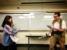 Beowulf fights Grendel.