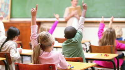 stock-footage-cute-children-raising-their-fingers-in-the-classroom