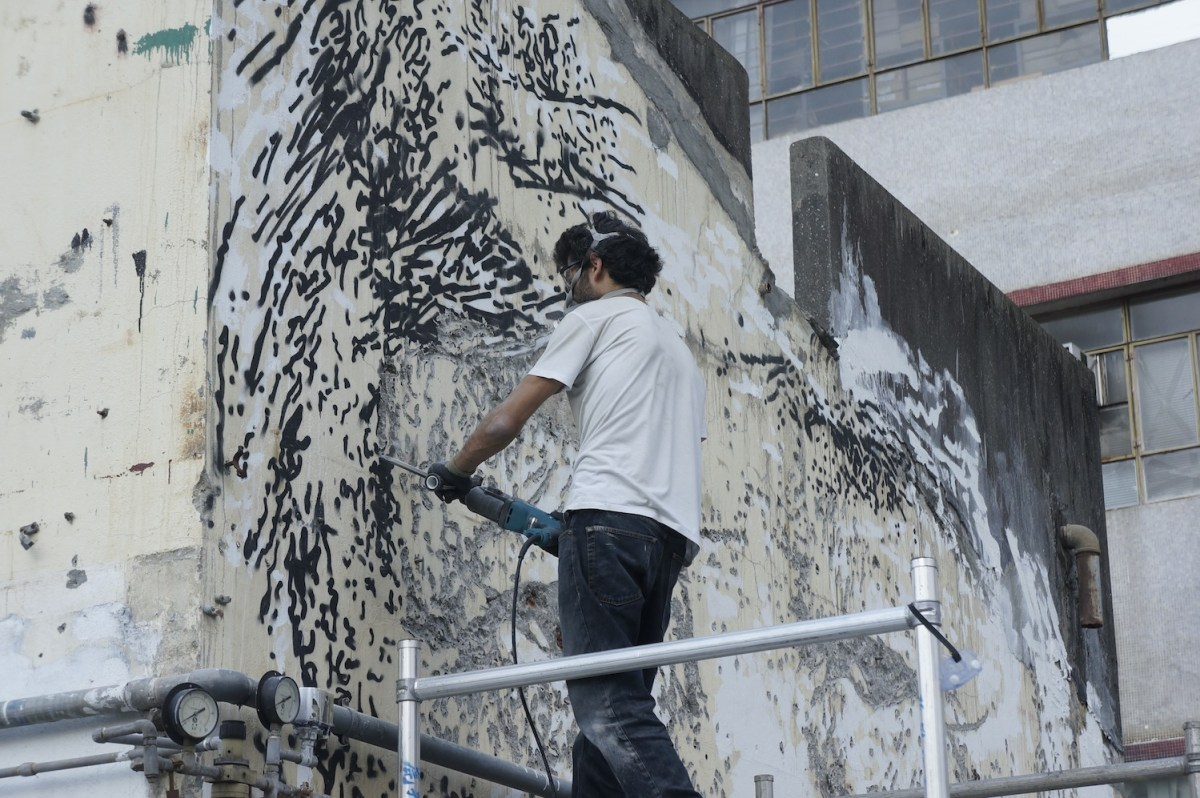 Vhils at work - Courtesy of the Mills