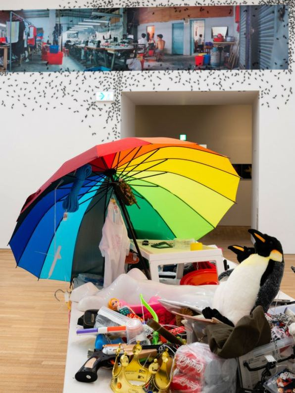"""Back: Liang Juhui, 'Construction of a Place and Ants', 1998. Mixed media, 120 × 755 cm. Installation view of """"Dismantling the Scaffold"""", Tai Kwun Contemporary, June - August 2018"""