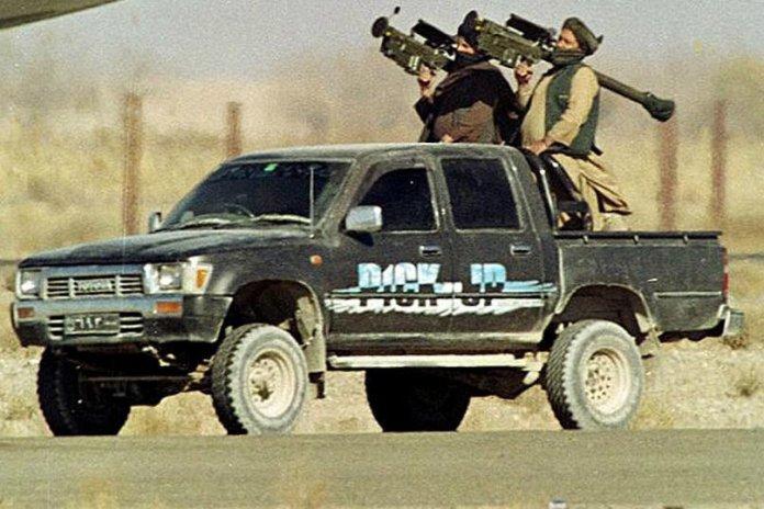 Taliban Islamic militia commandos pass by the nose