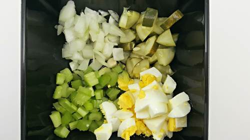 onions, pickles, celery, chopped eggs in a bowl