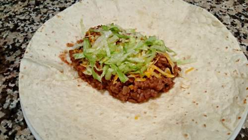 tortilla with meat, cheese, lettuce