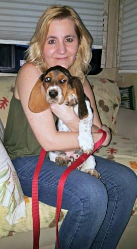 Bugatti the basset hound puppy and me holding him