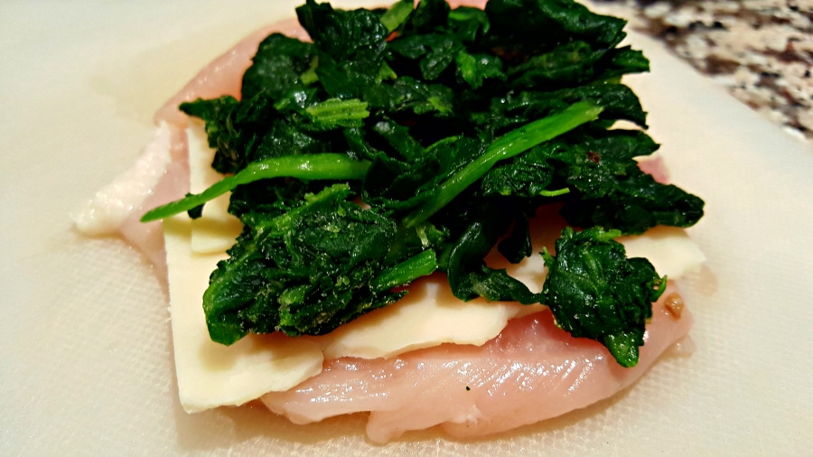 chicken topped with garlic, cheese, and spinach