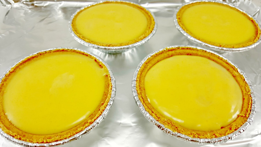 Individual Key Lime Pies pour mixture into crusts