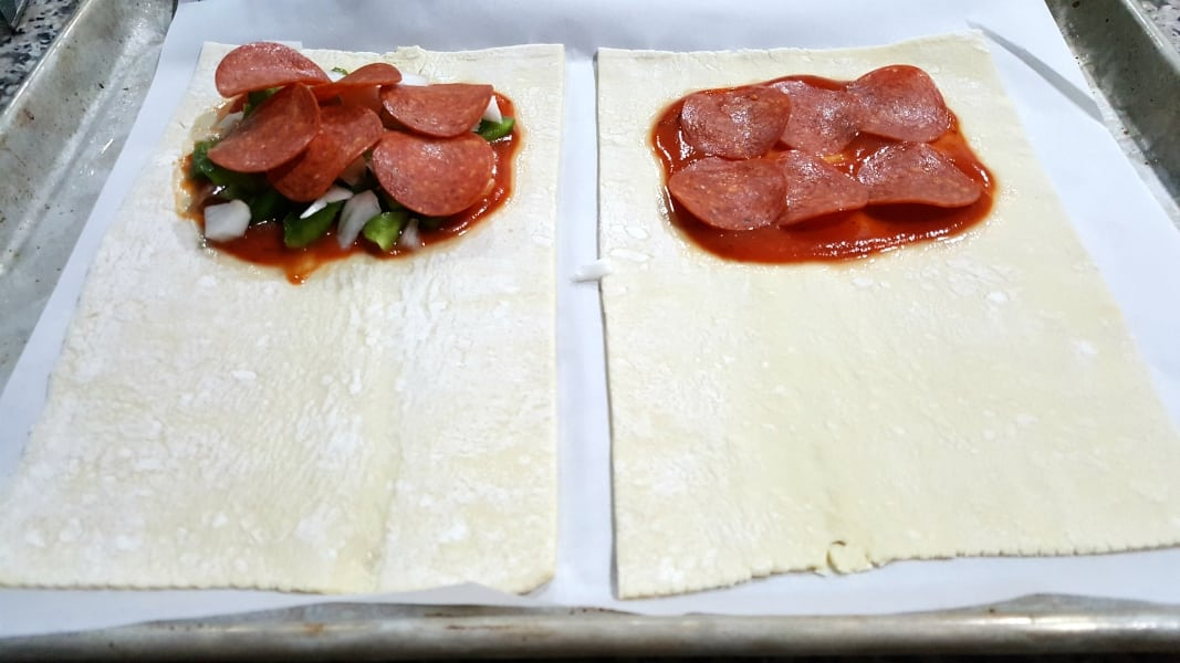 Cheesy Pizza Puff Pastry Calzones Recipe for Two - add sauce, pepperoni, and optional toppings