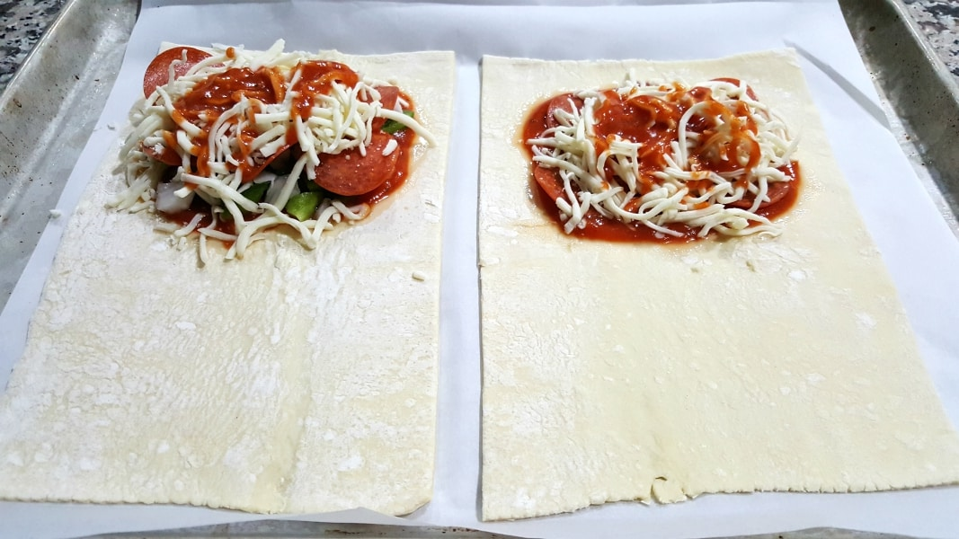 Cheesy Pizza Puff Pastry Calzones Recipe for Two - add mozzarella and more sauce