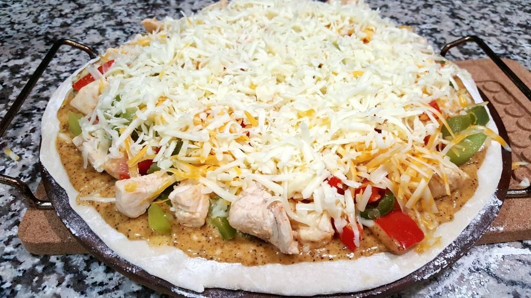Chicken Fajita Pizza Recipe - sprinkle shredded cheese over the veggie mixture