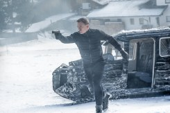 Bond (Daniel Craig) leaping from the sliding damaged plane gun drawn in Metro-Goldwyn-Mayer Pictures/Columbia Pictures/EON Productions' action adventure SPECTRE. Obertilliach, Austria.