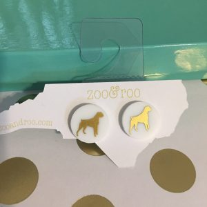 white earrings with gold boxer