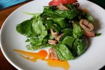 Spinach salad, calamari, white nectarine, toasted coconut dressing