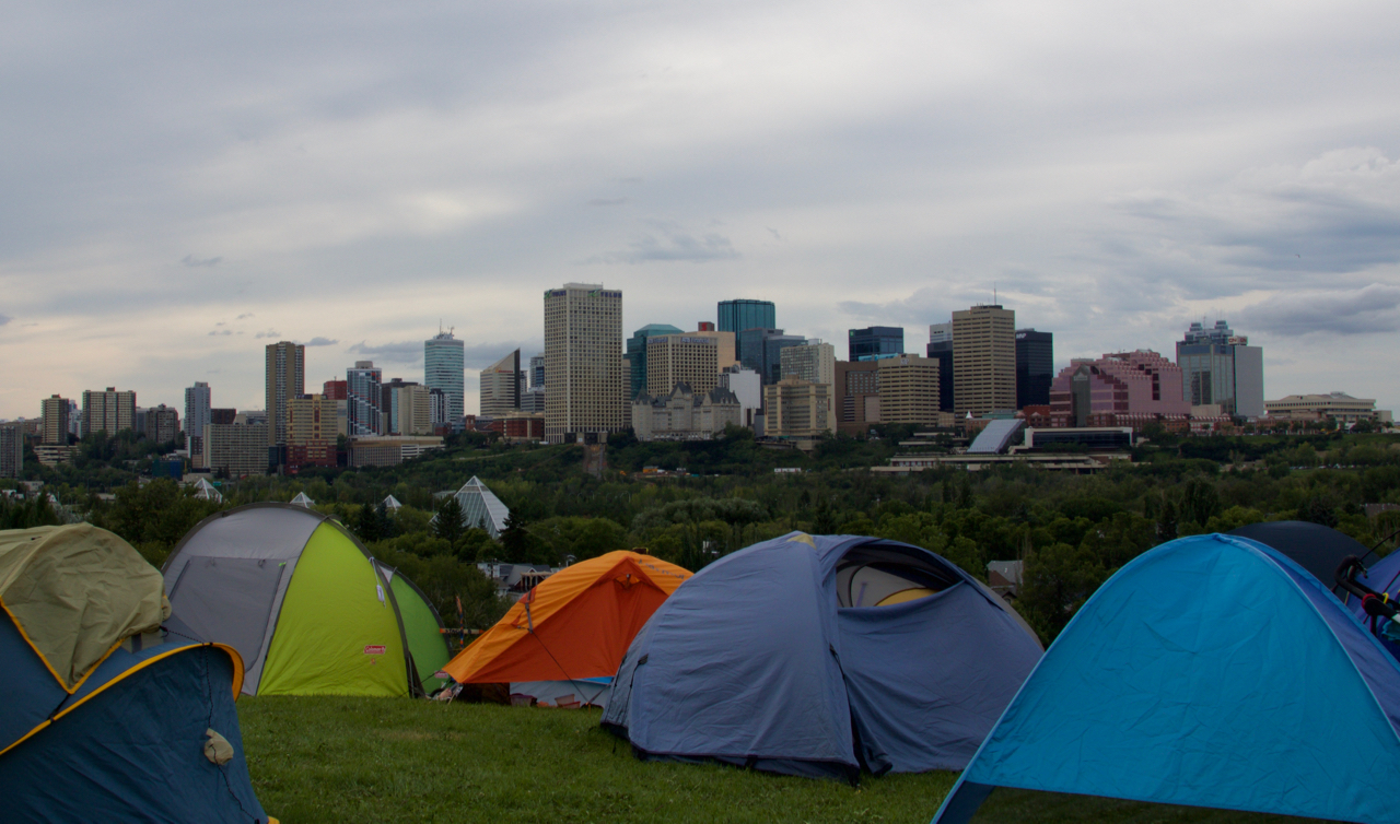 I like the juxtaposition between the skyline of the 2 cities Edmonton and Folk Fest : tents edmonton - memphite.com