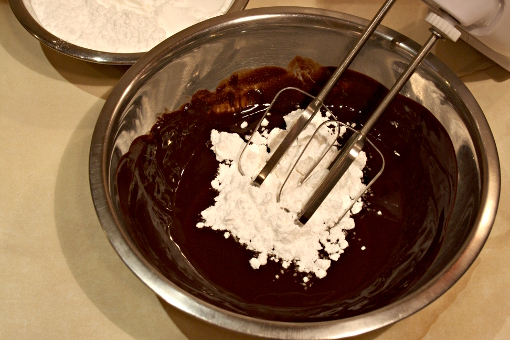st-martins-cake-adding-sugar-to-melted-butter-and-chocolate-for-frosting