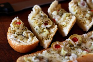 garlic cheese bread with olives recipe with step by step pictures, recipe, ingredients, pictures, images