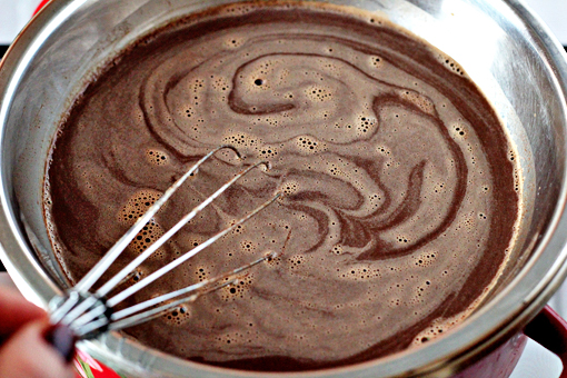 homemade hot chocolate recipe with step by step pictures, place the bowl over a pot of boiling and steaming water, stir until the chocolate melts, keep stirring until the mixture gets hot, nearly boiling