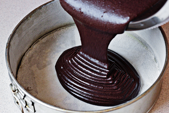 Chocolate Cake With Chocolate Buttercream Frosting, Line the bottom of a 9 x 2-inch (23 x 5 cm) springform pan or a round baking pan with parchment paper. Grease it and dust it with flour, Pour the cake mixture into the pan