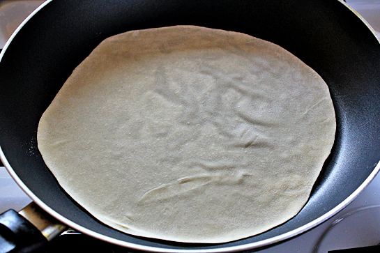 homemade tortillas recipe with step by step picture instructions, preheat a large skillet or a frying pan over medium-high heat, place a tortilla on the pan and let it cook for about 30 seconds, no oil or butter is needed, there's enough fat in the dough